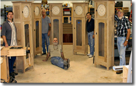 Dale resting amid students with their completed clocks.